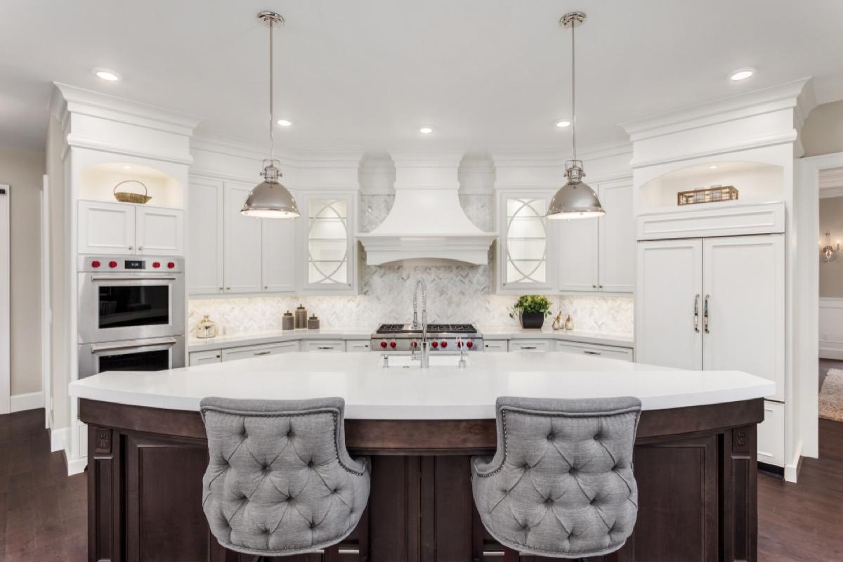 modern kitchen with white island