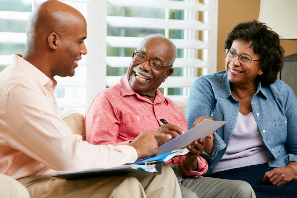 older couple speaking with financial professional, downsizing your home