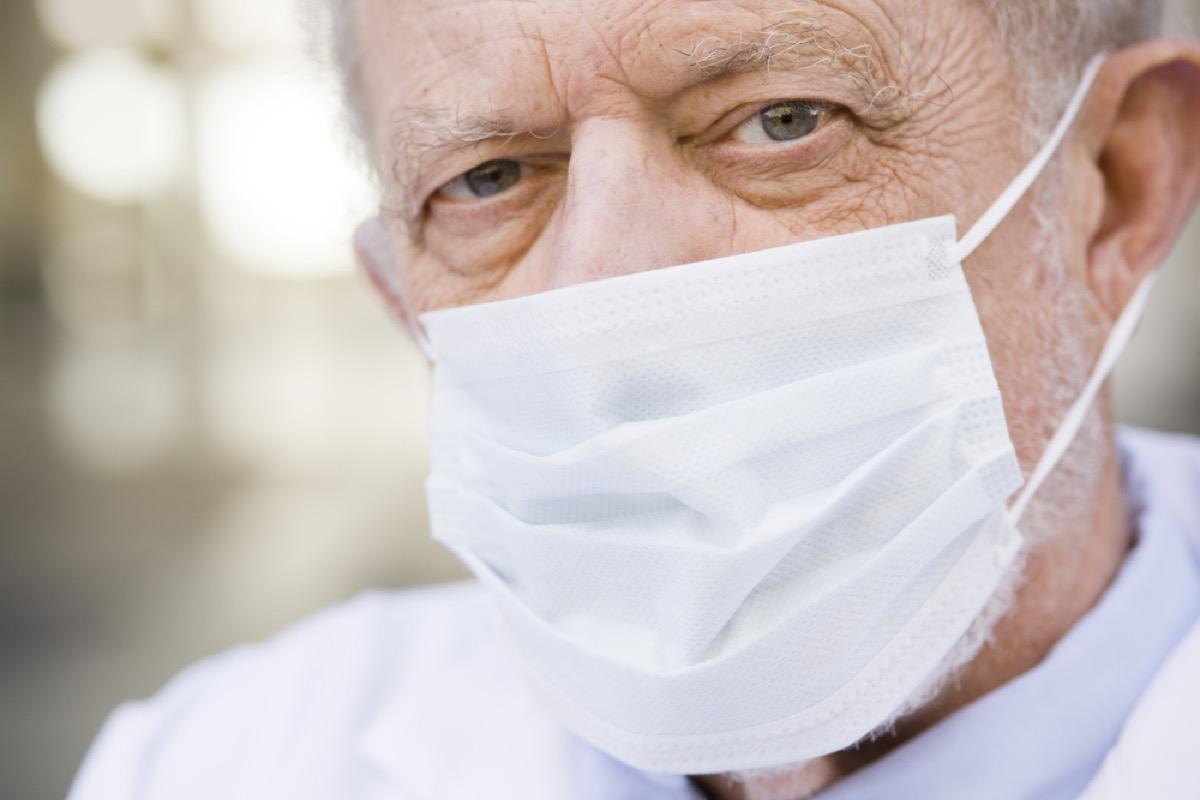 older man wearing paper mask over face, heart risk factors