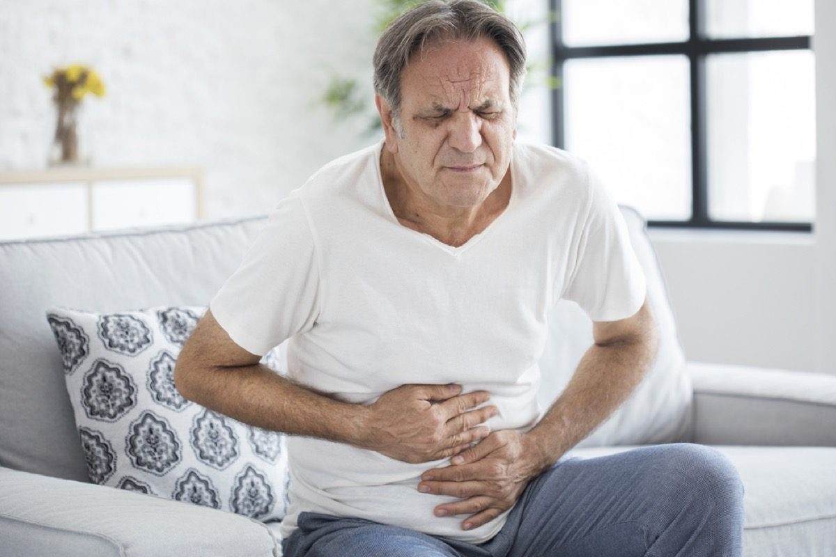 older man with stomach pain, stomach symptoms