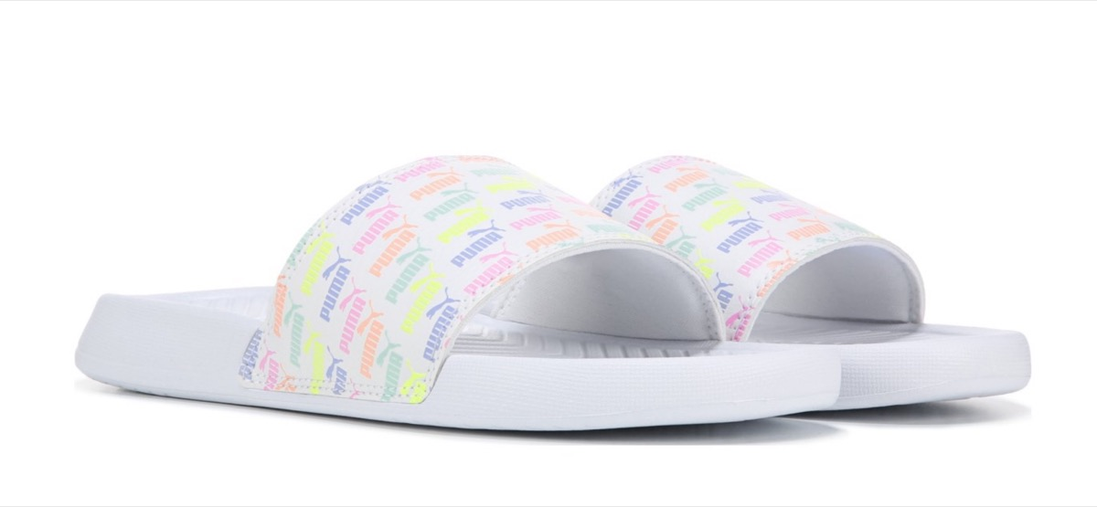white slides with multicolor puma logos, affordable sandals