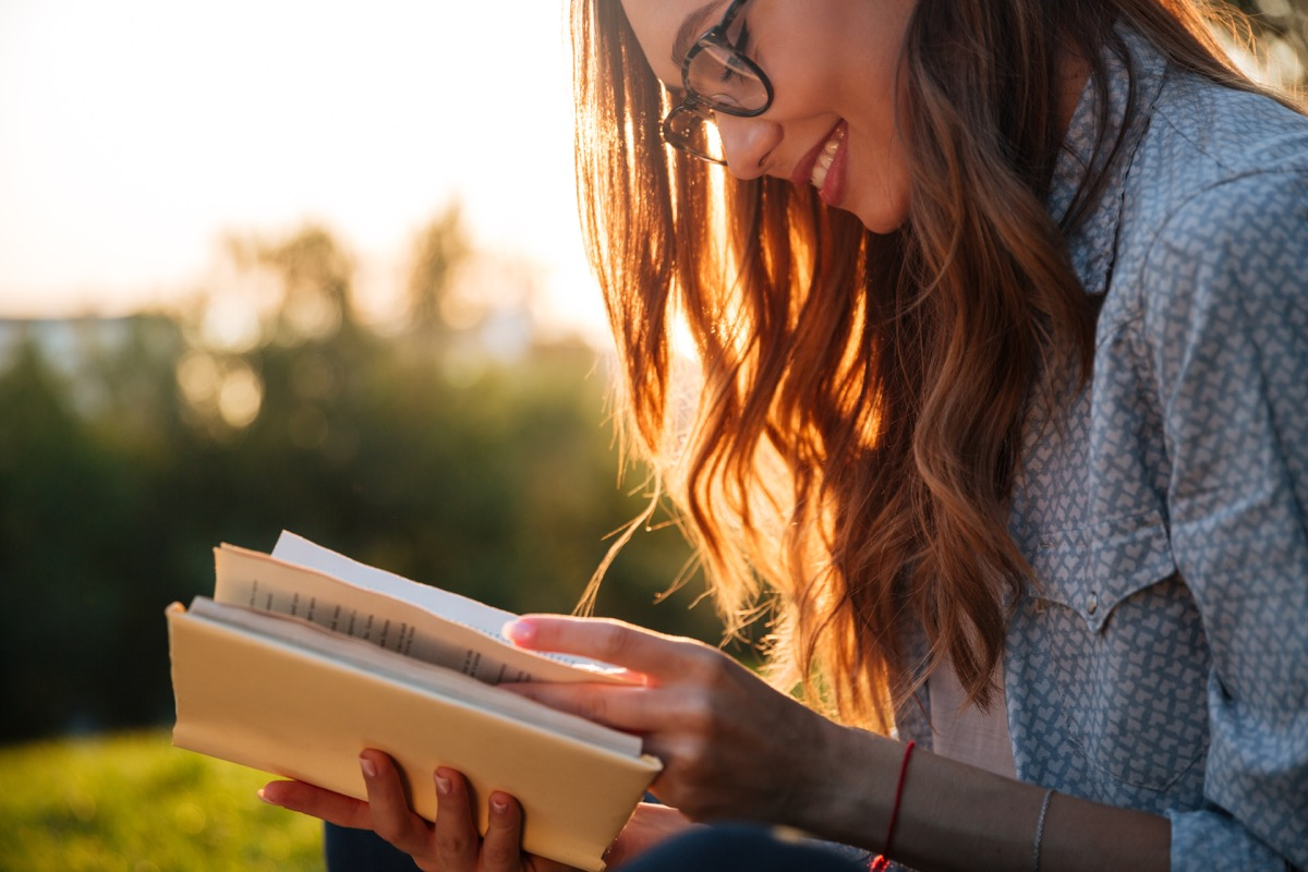 girl reading book or dictionary, new words coined