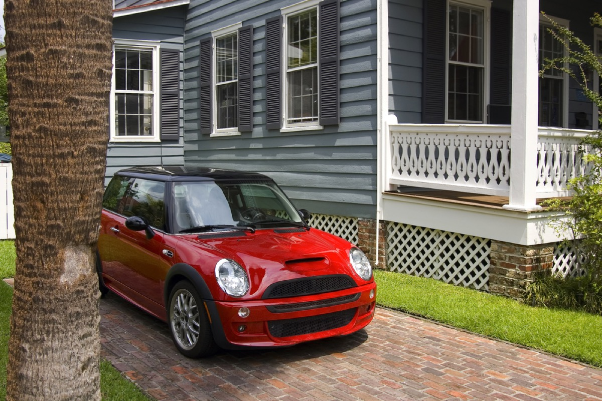 fiat mini parked outside victorian home, get rid of kids stuff