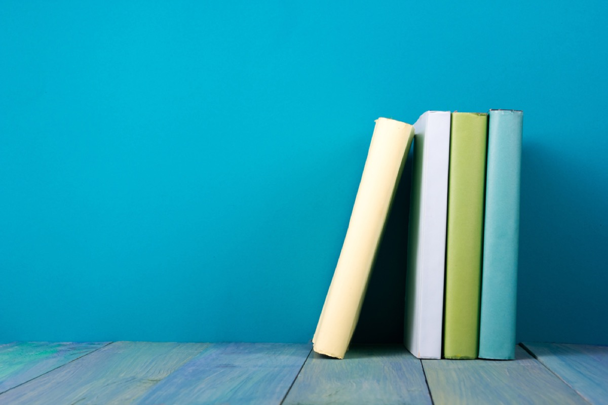set of green books against blue background