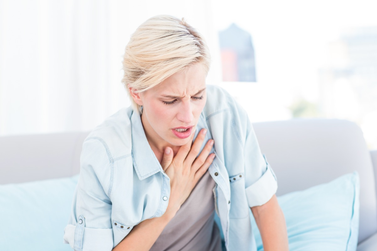 Woman having trouble breathing
