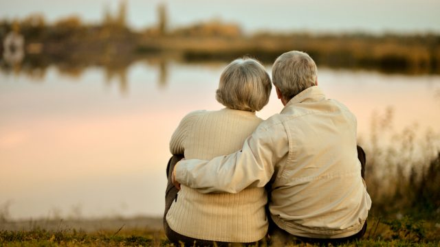 happy elderly couple gazing at sunset, healthy sex after 40