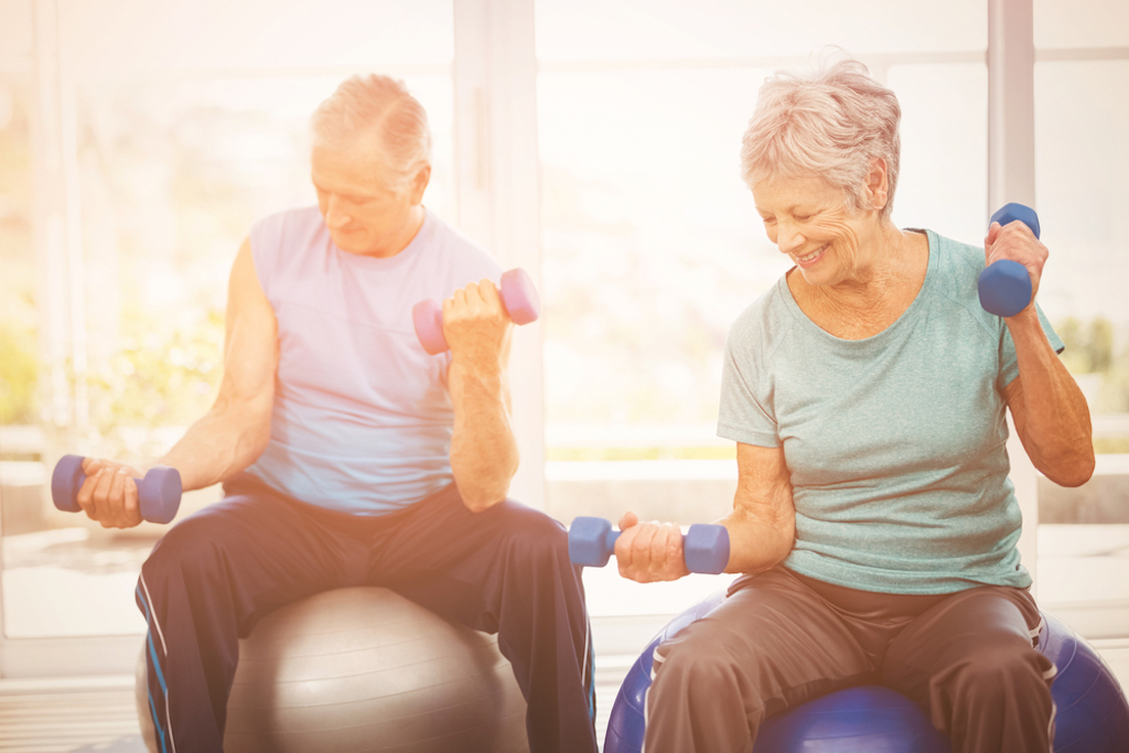 elderly couple happily exercising