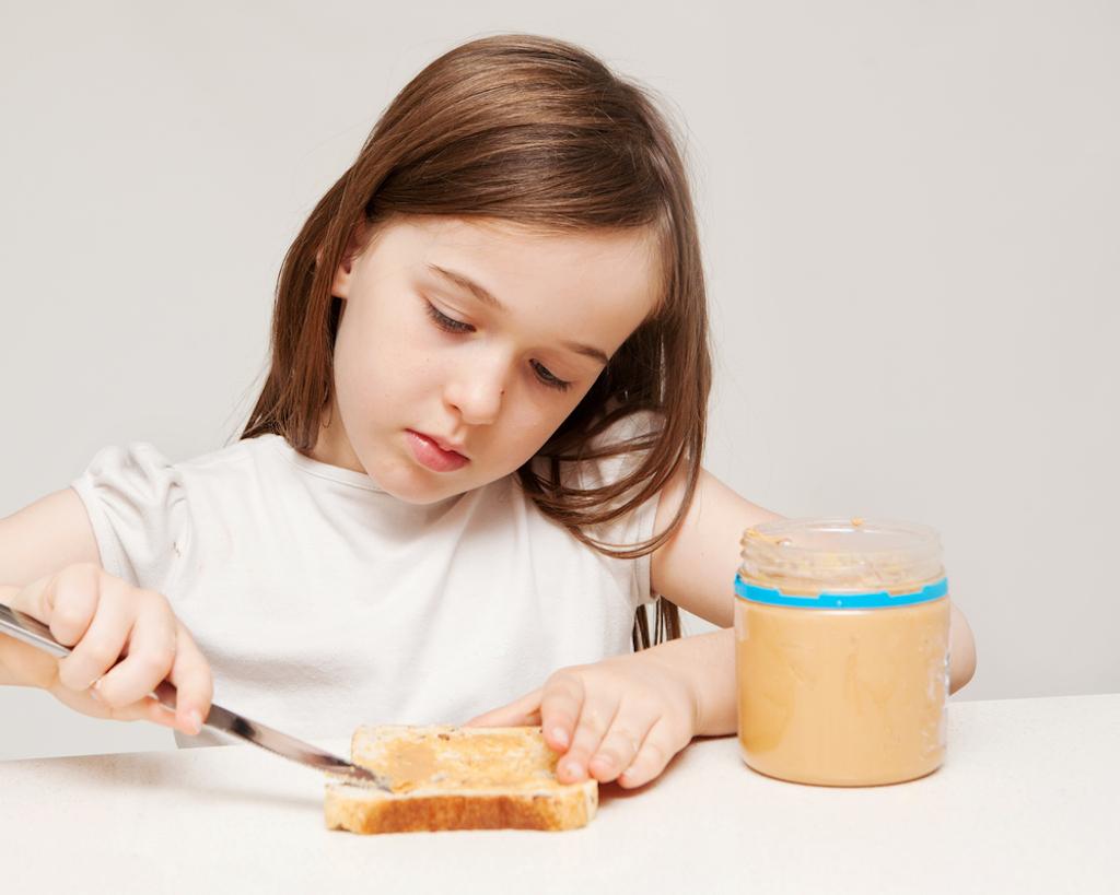 girl making peanut butter sandwich