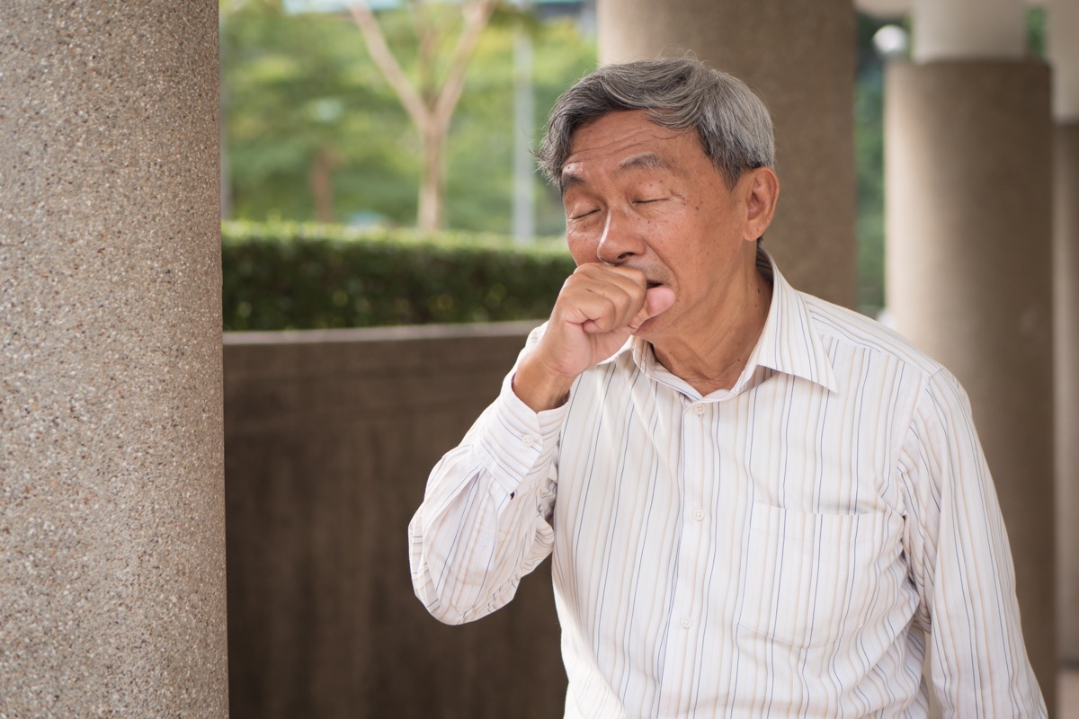 sick man coughing outside
