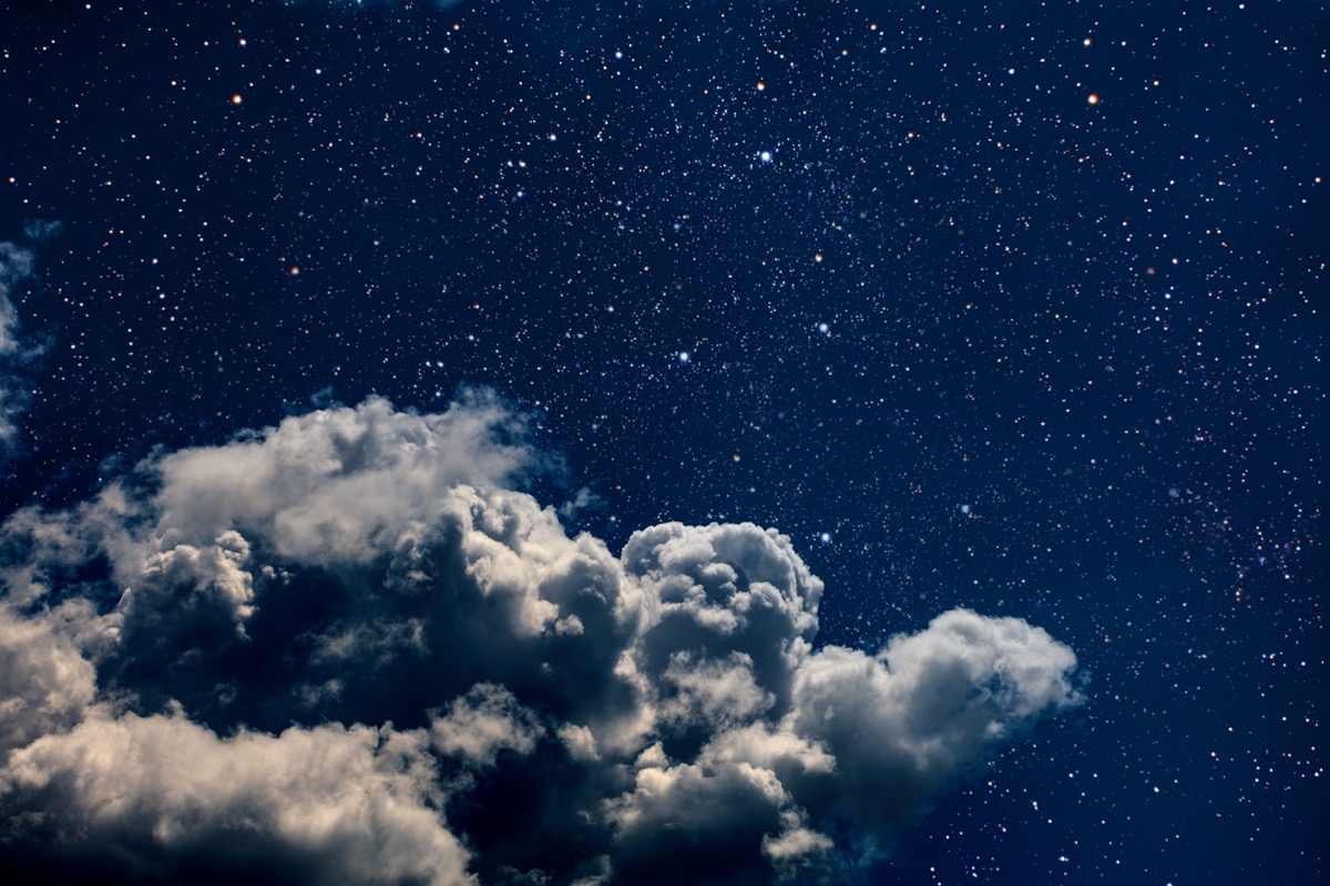 A cloud in space surrounded by a million stars