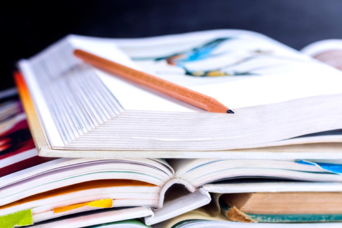pile of textbooks, get rid of kids stuff