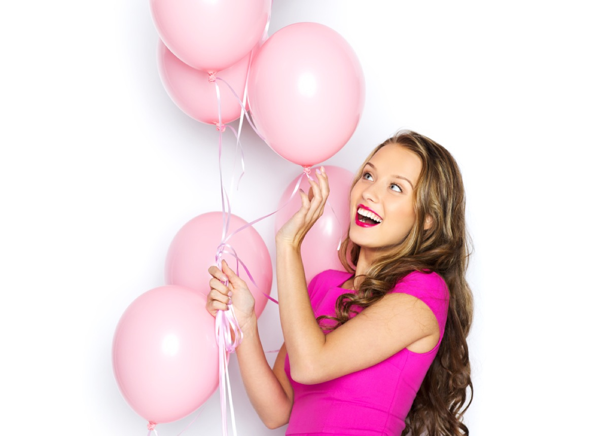 teen girl holding pink balloons, bad parenting