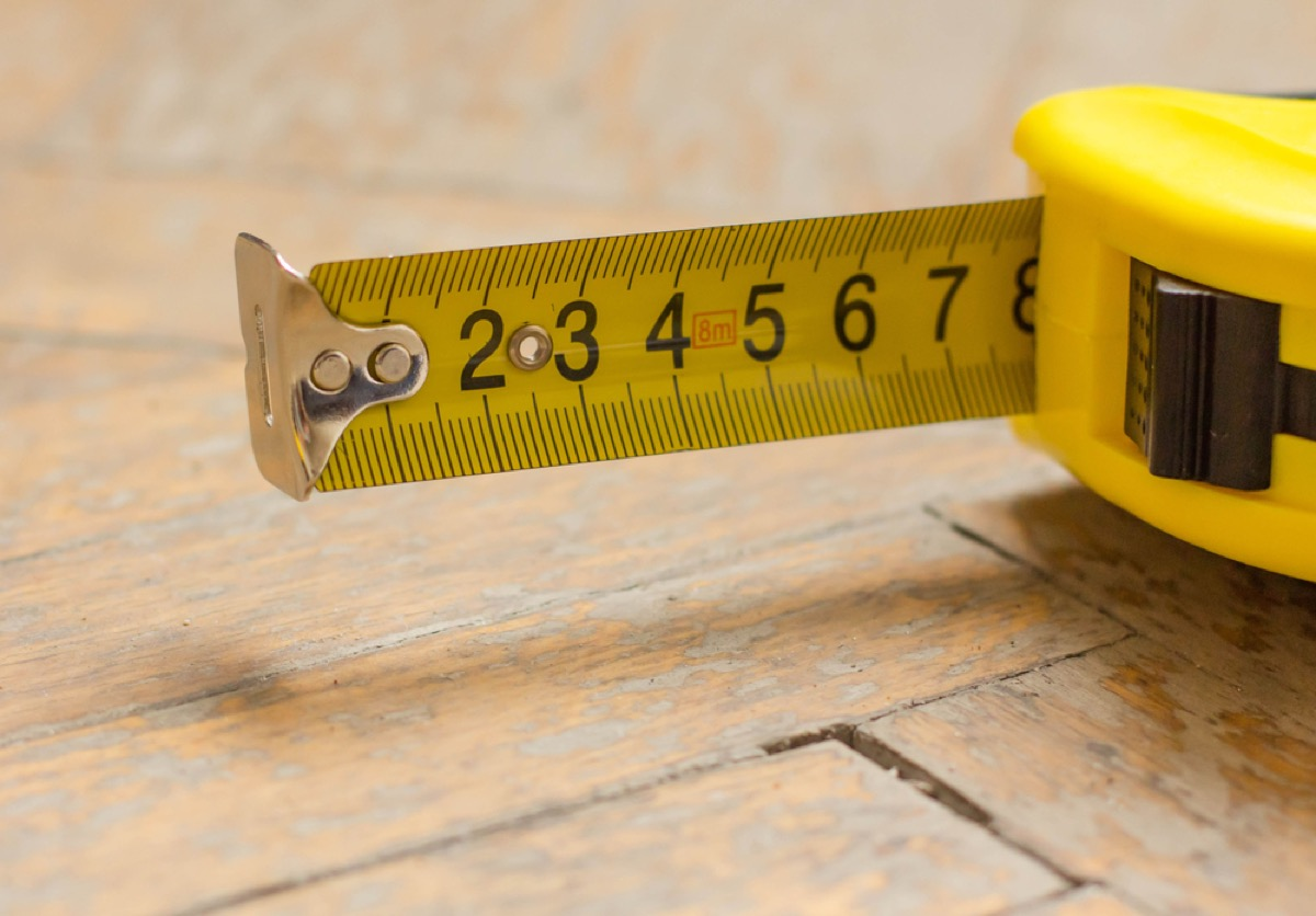 yellow tape measure, downsizing your home