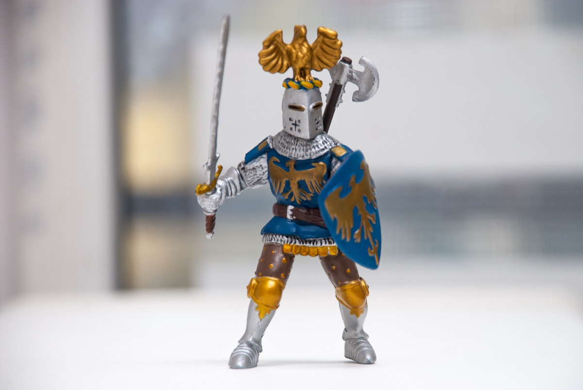 an action figure size toy wearing battle armor and holding a sword