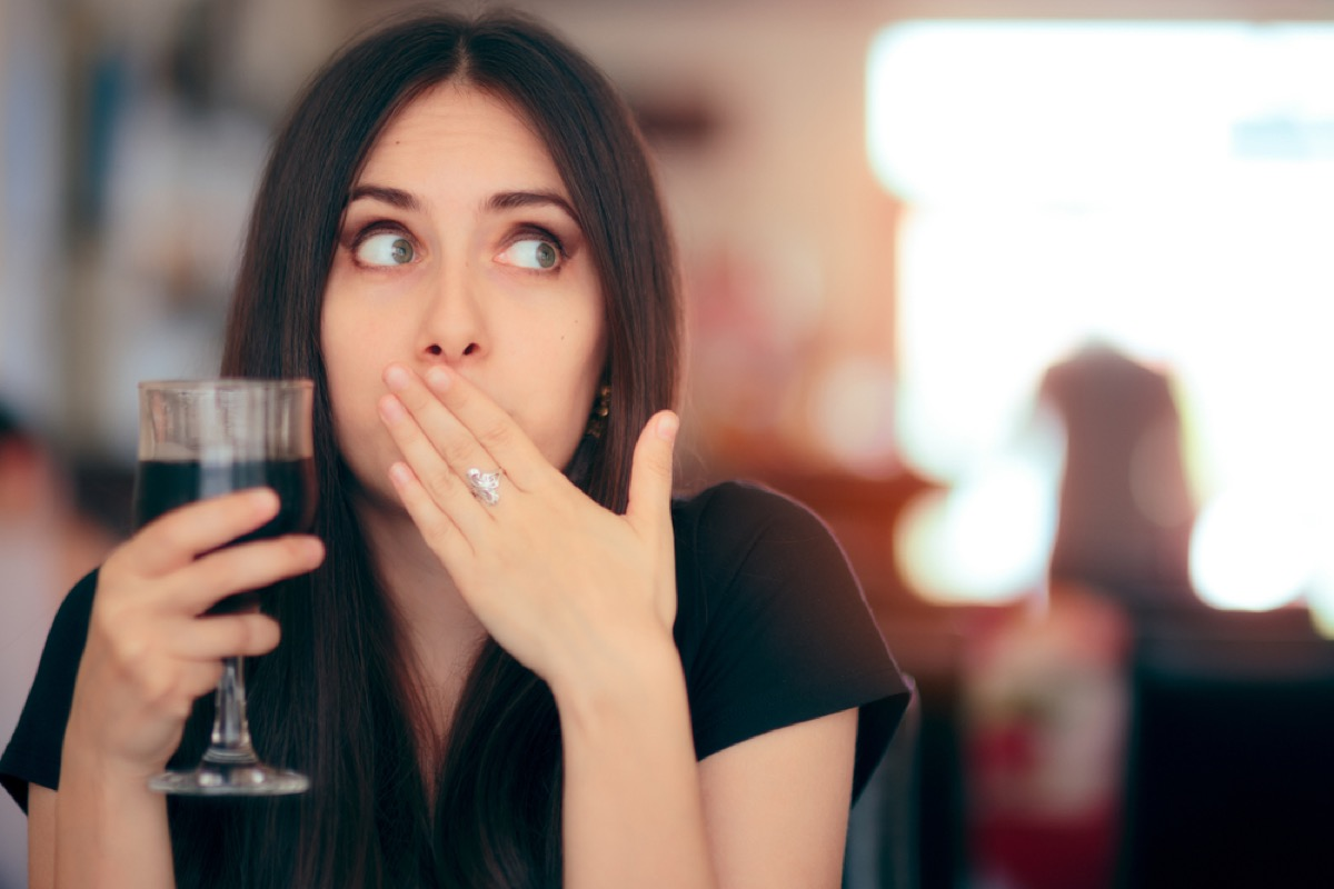woman belching, subtle symptoms of serious disease
