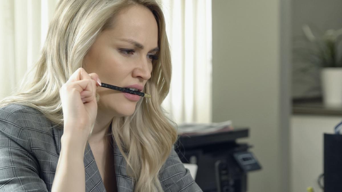 woman chewing pencil, ways you're damaging teeth