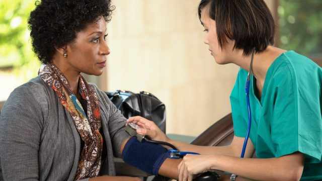 Woman at the Doctor Getting Her Blood Pressure Checked Lower Blood Pressure Naturally