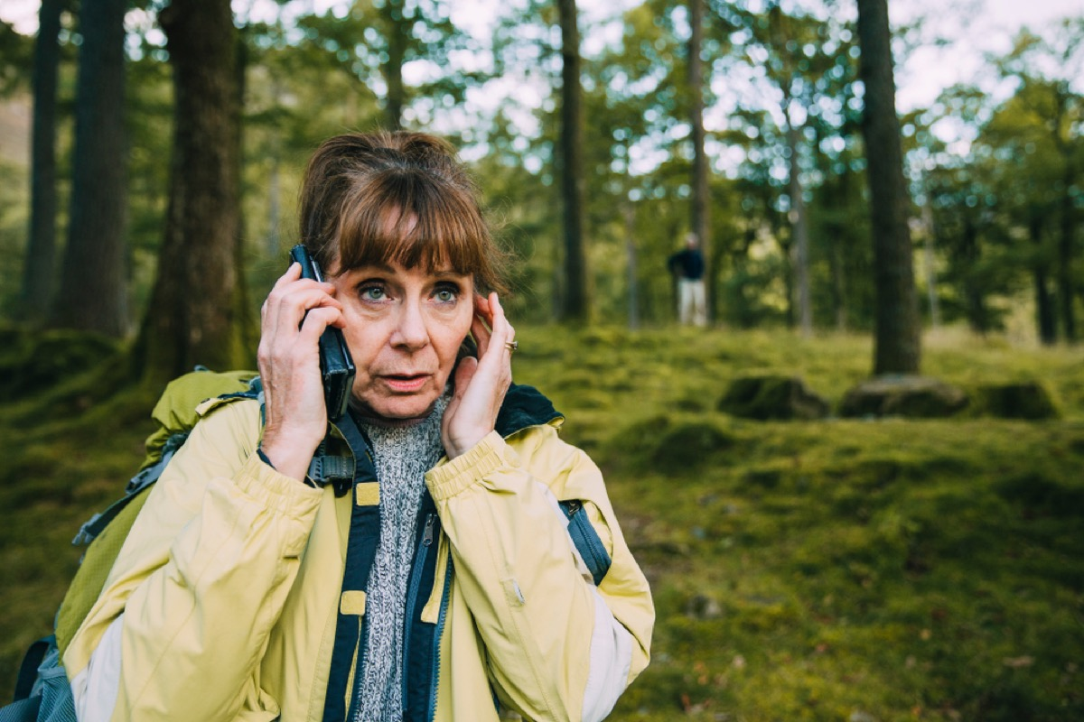 senior woman lost in the woods