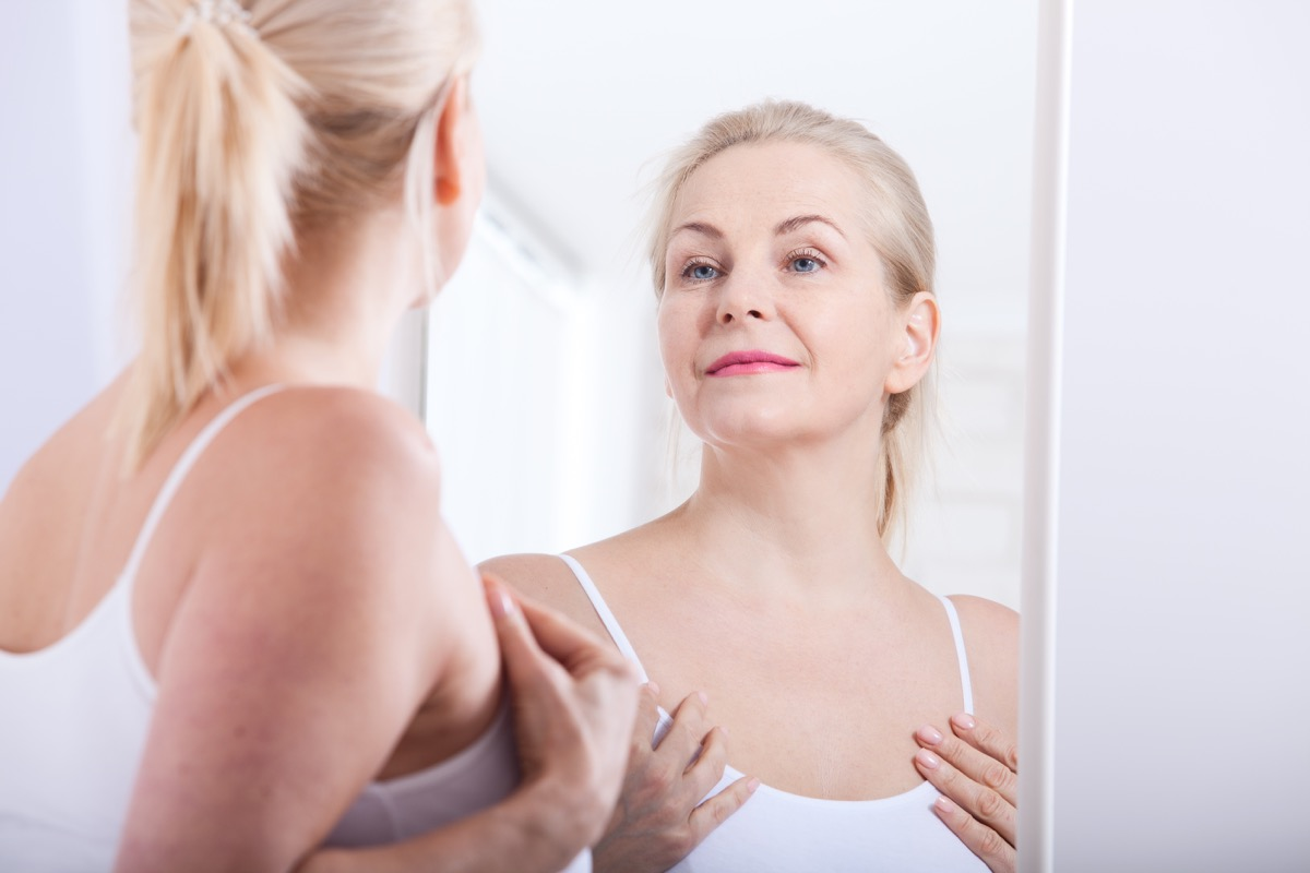 woman looking in mirror, long marriage tips