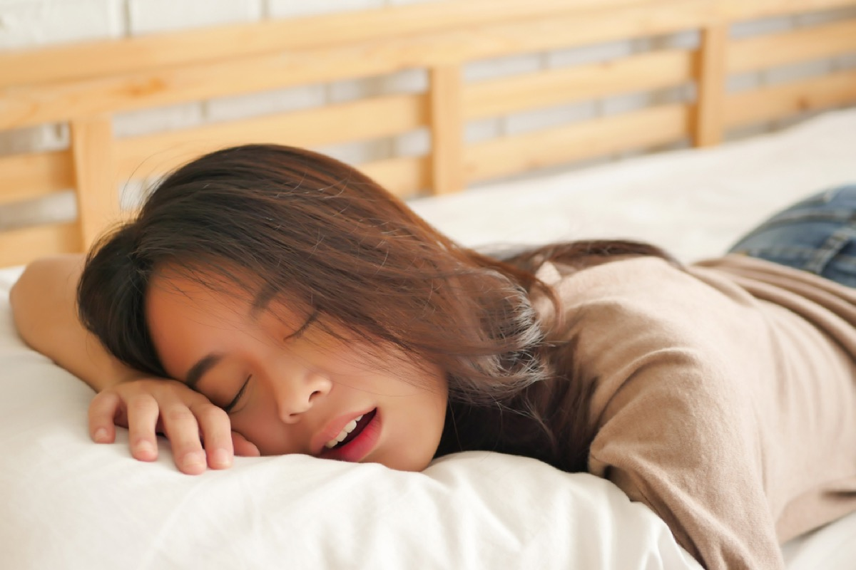 asian woman sleeping with her mouth open, ways you're damaging teeth