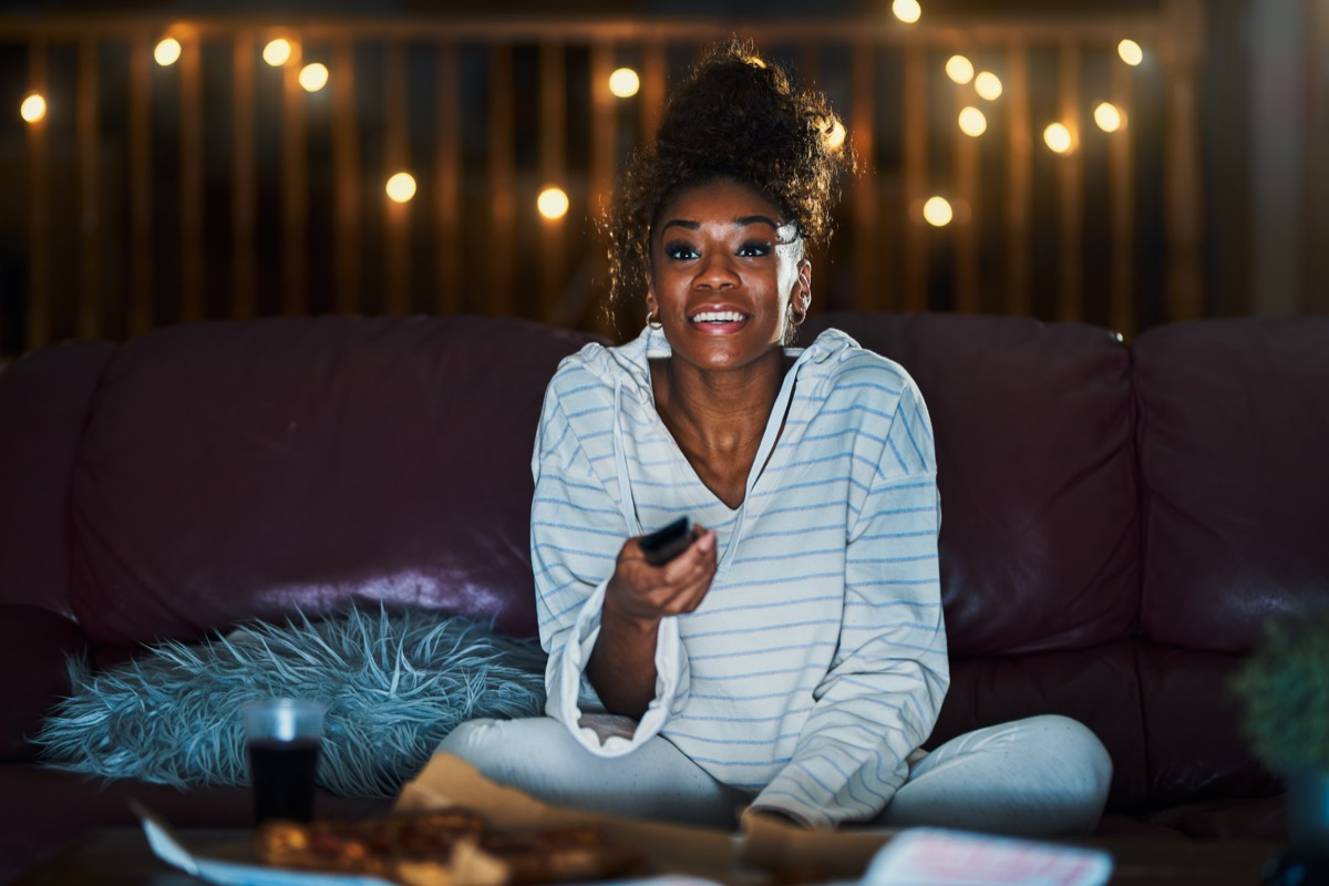 Woman Staying Up Late Watching TV