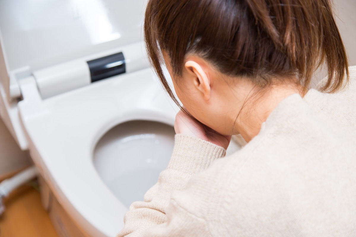 woman vomiting into toilet unexpected signs your heart is unhealthy