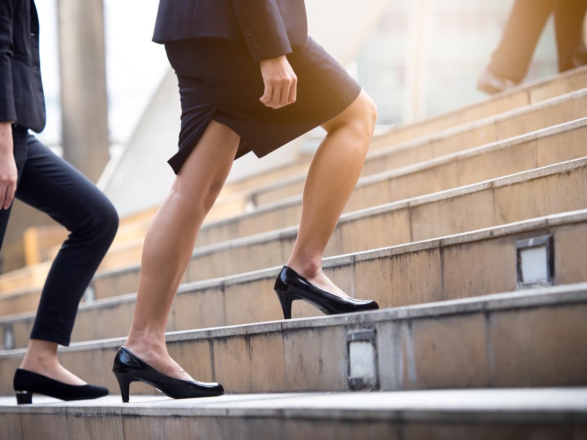 woman walking up steps in heels