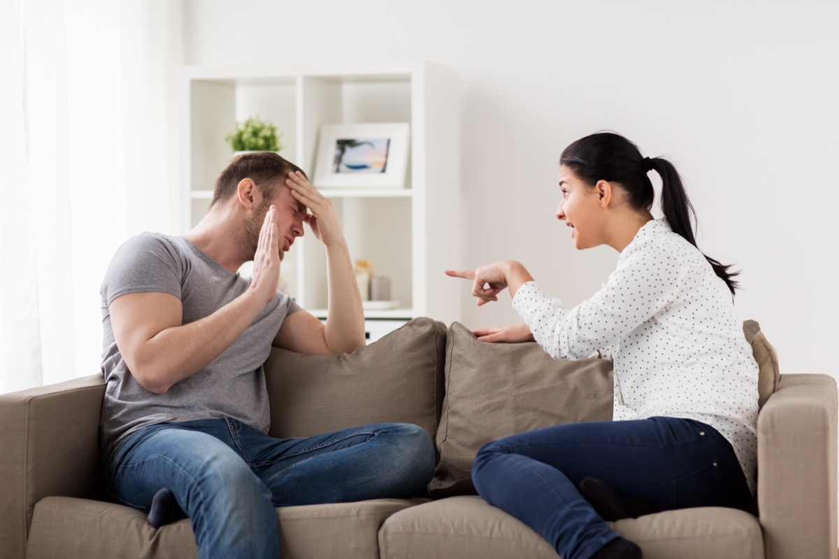 young white woman yelling at man on couch
