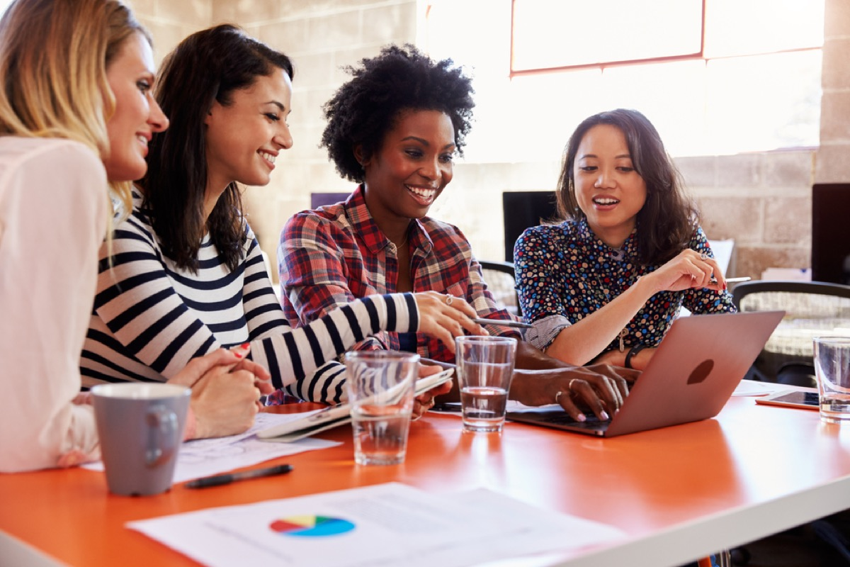 women working together at a table, office etiquette