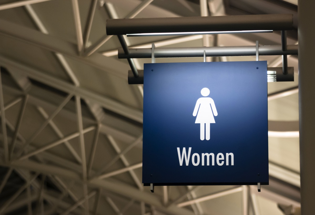 a sign for the womens room