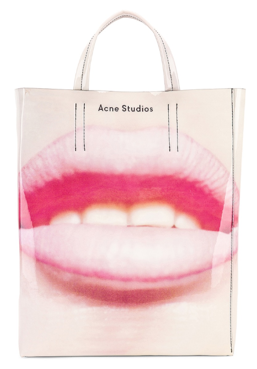 large tote with graphic design of lips on the front, luxury beach bags