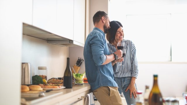 couple enjoying date night at home - at-home date night ideas