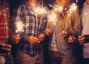 people holding sparklers outside, bug products
