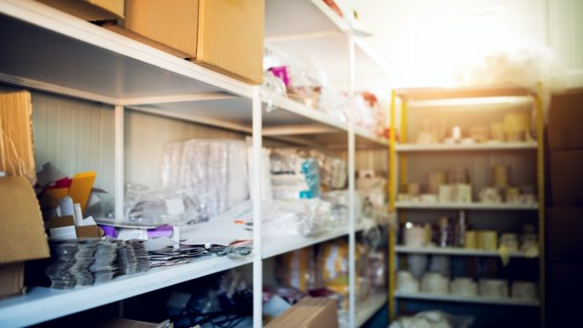cluttered basement storage racks