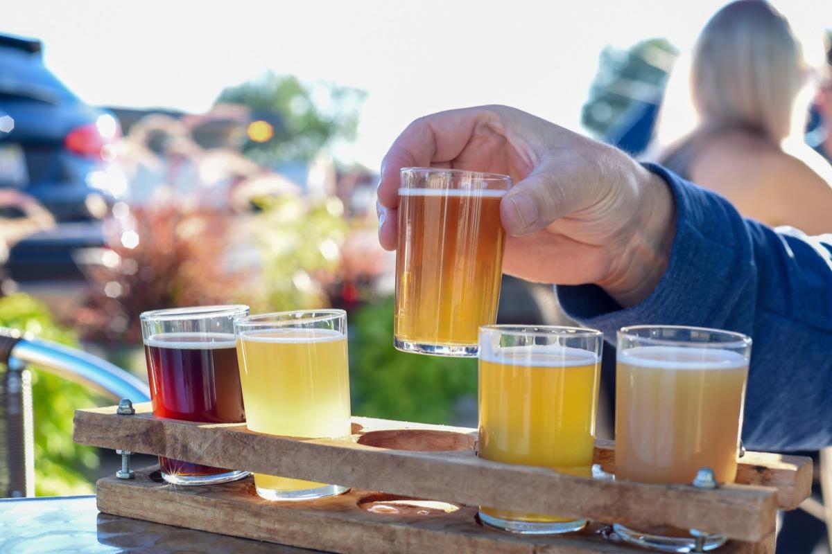 Man sampling a variety of seasonal craft beer at an outdoor beer garden