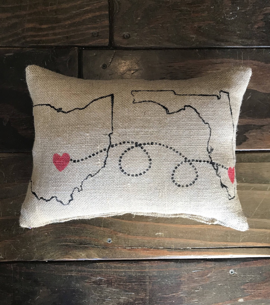 burlap pillow with the outline of two states on it, best friend gifts