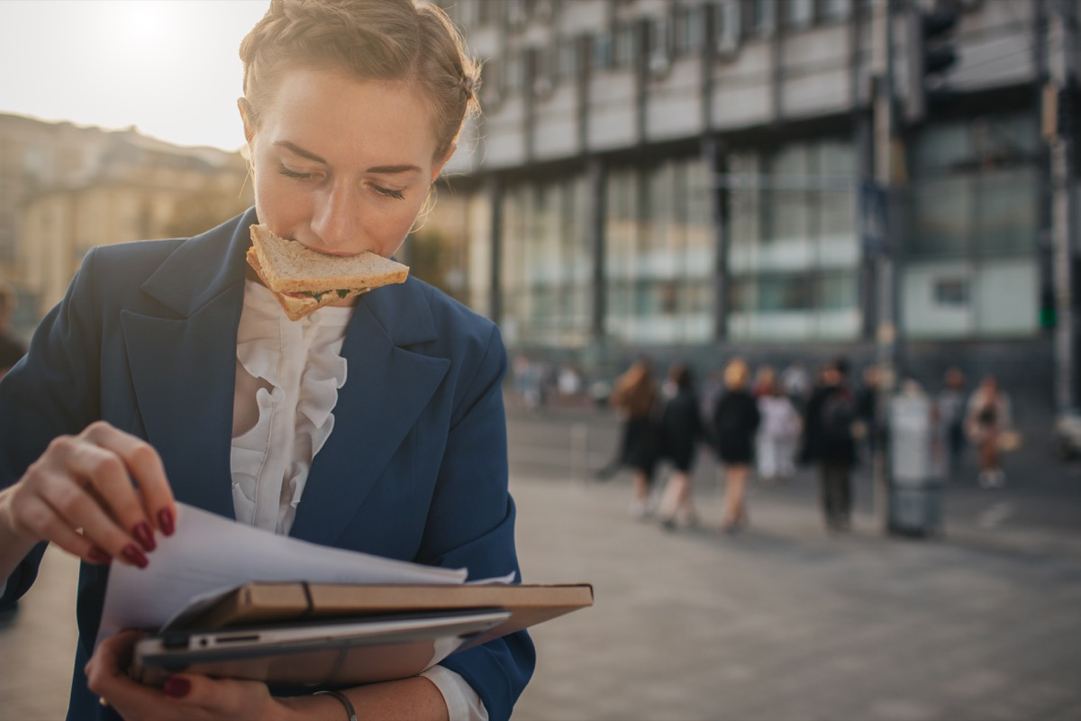 disorganized business person holds papers