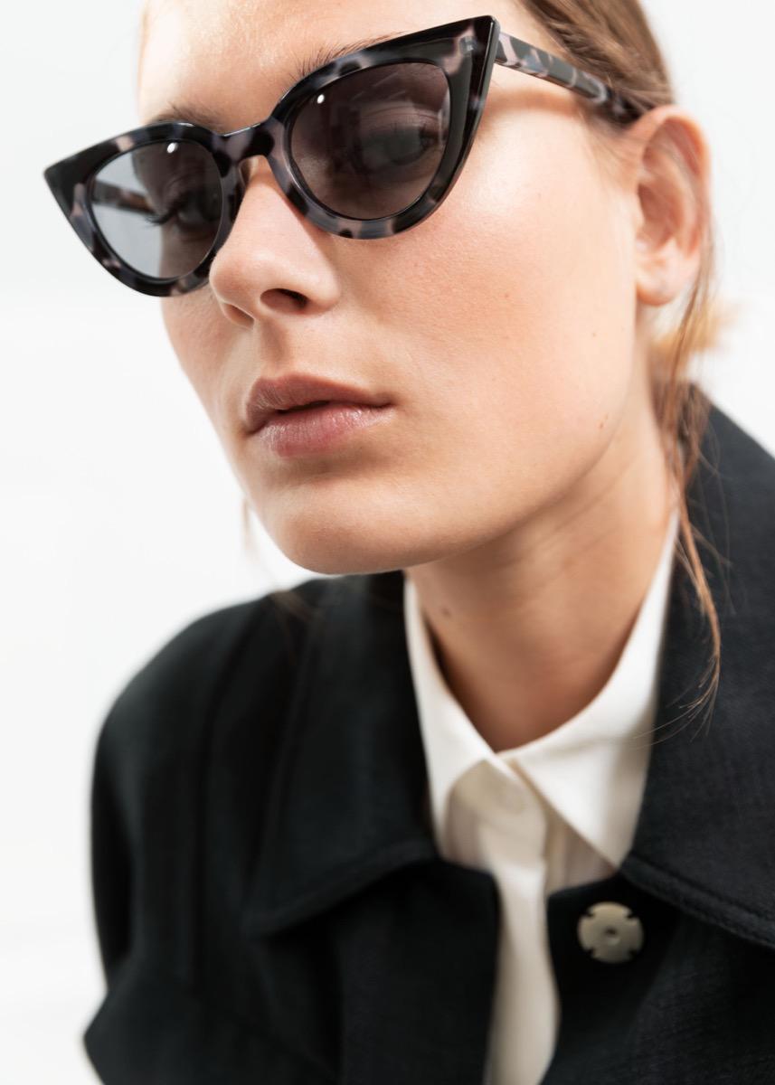 woman wearing cat eye sunglasses, best gifts for girlfriend