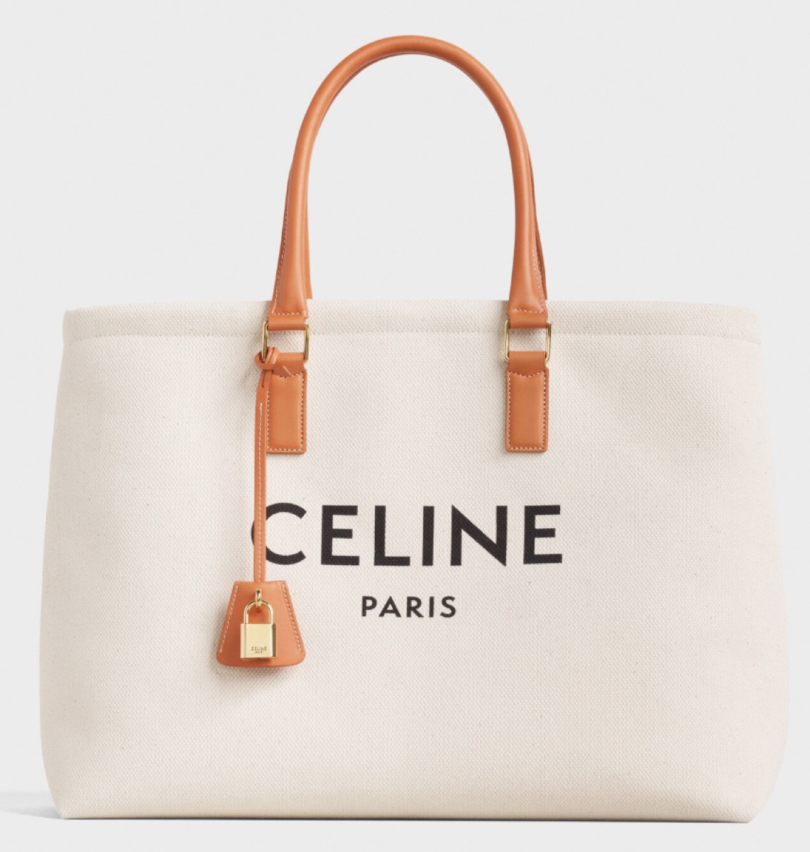 white canvas tote with leather handle and celine logo, luxury beach bags