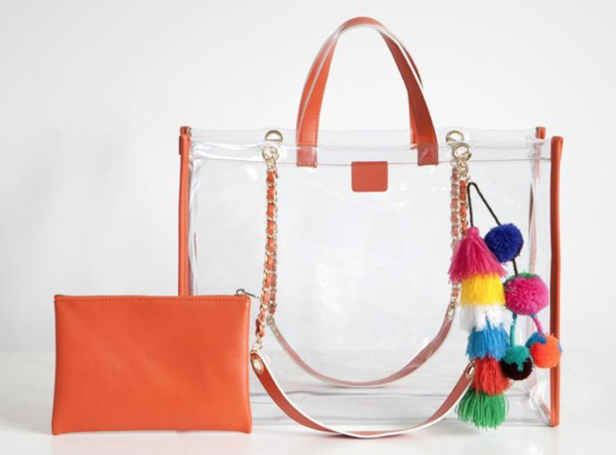 clear tote with pom poms, luxury beach bags