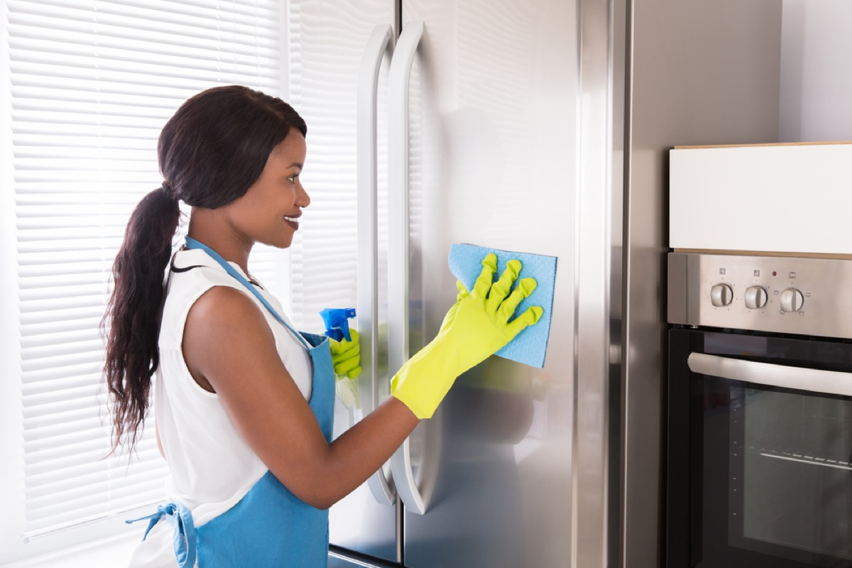 woman cleaning fridge, old school cleaning tips