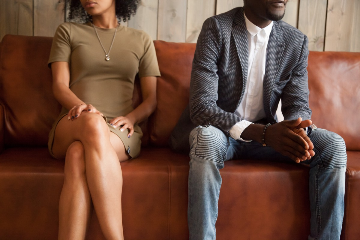 Couple on a Couch Fighting Lies Ex-Spouses