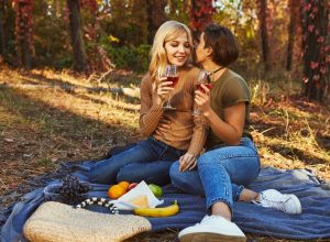 couple in love having a picnic, best anniversary date ideas