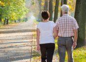 Elderly couple walking outside in the morning sunshine