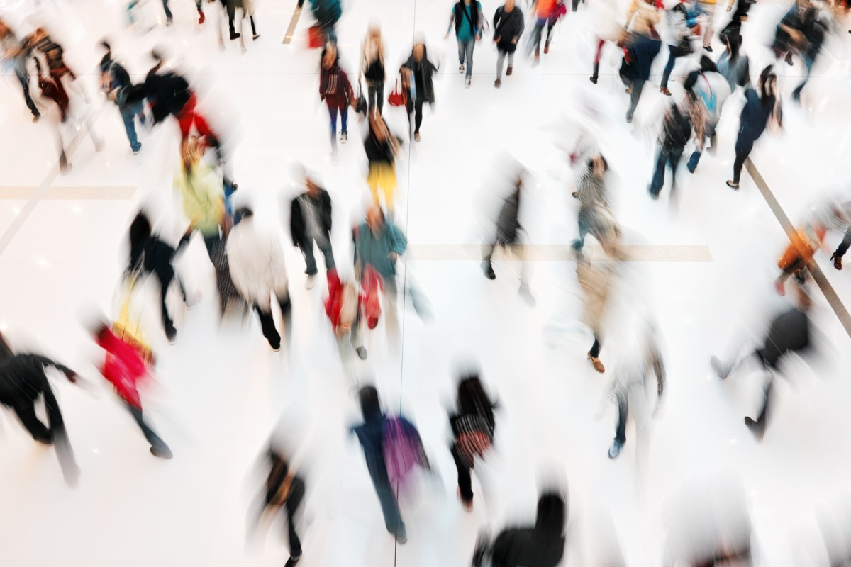 crowd of people in a rush shopping