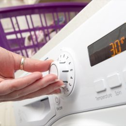 Person Using a Dryer to Dry Their Clothes Ways You Ruin Clothing