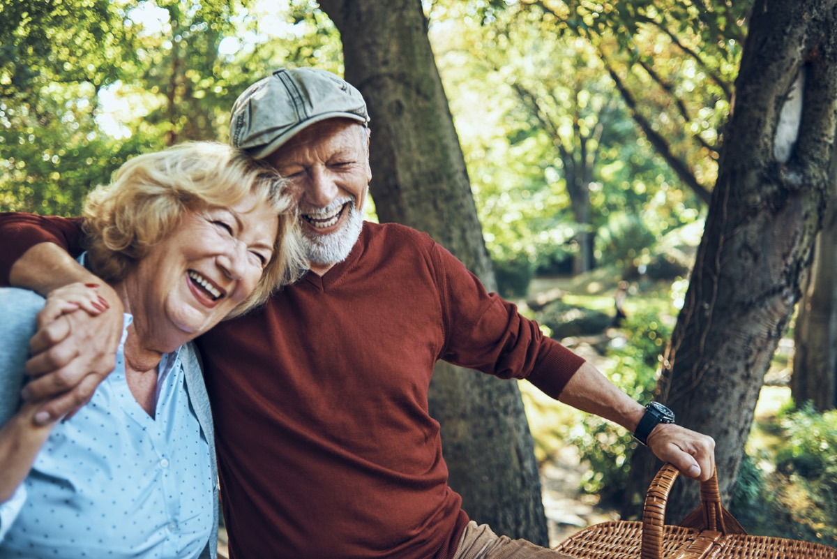 elderly couple laughing and smiling