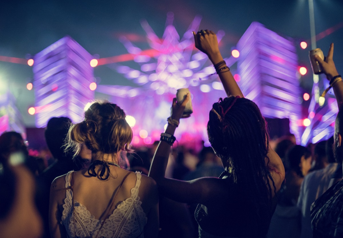 female friends at a concert things women do with their friends