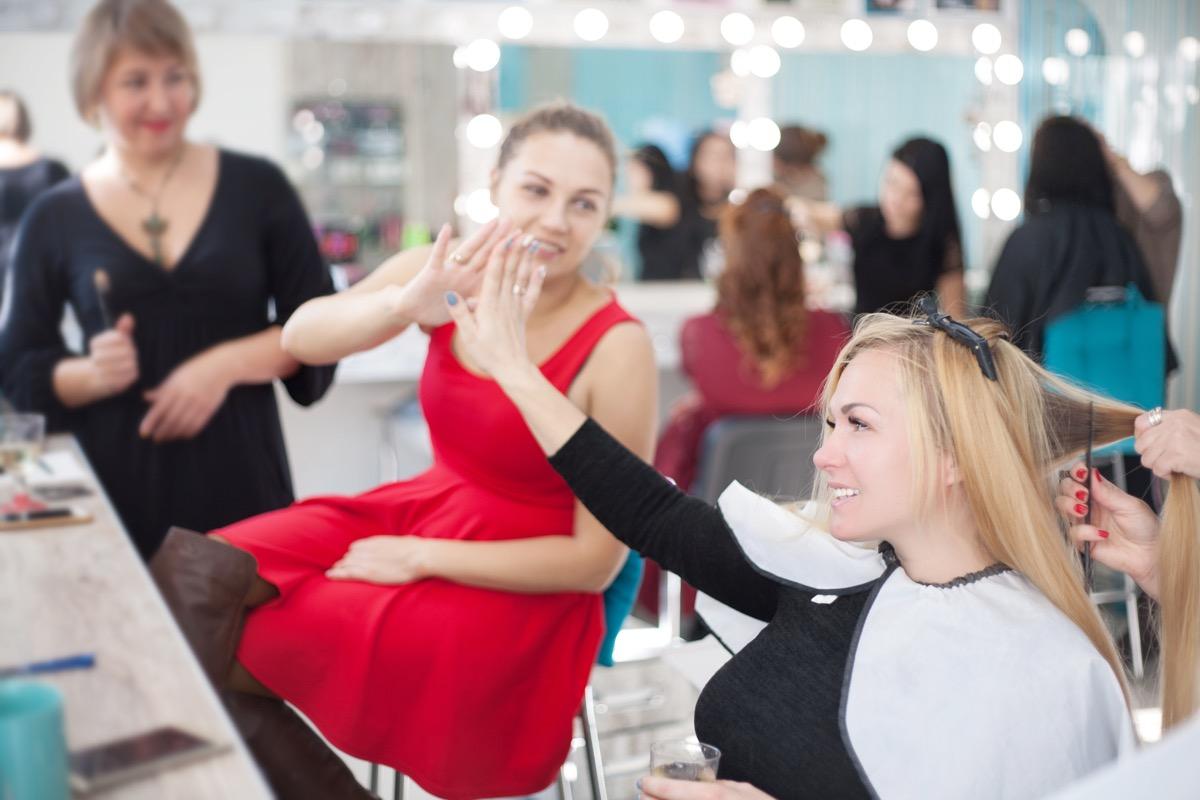 friends getting haircut in hair salon things women do with their friends