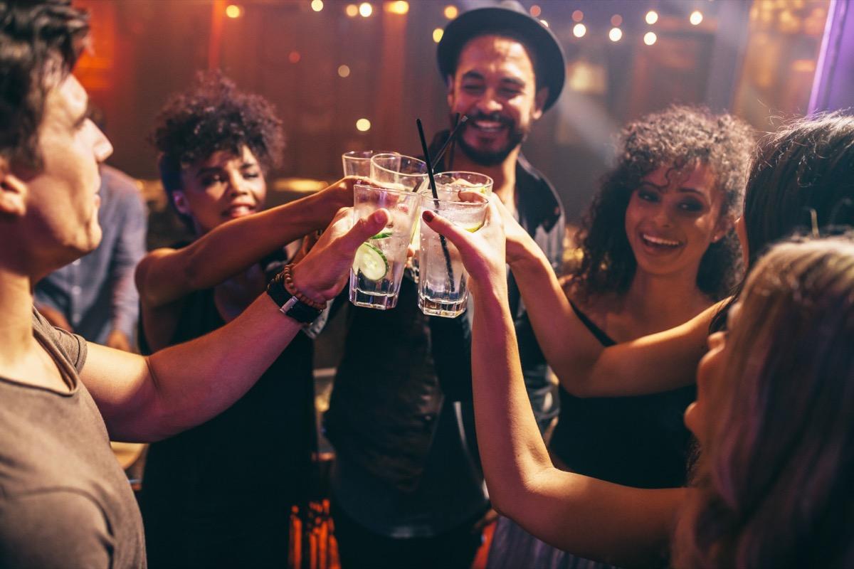 friends having drinks at bar gross everyday habits
